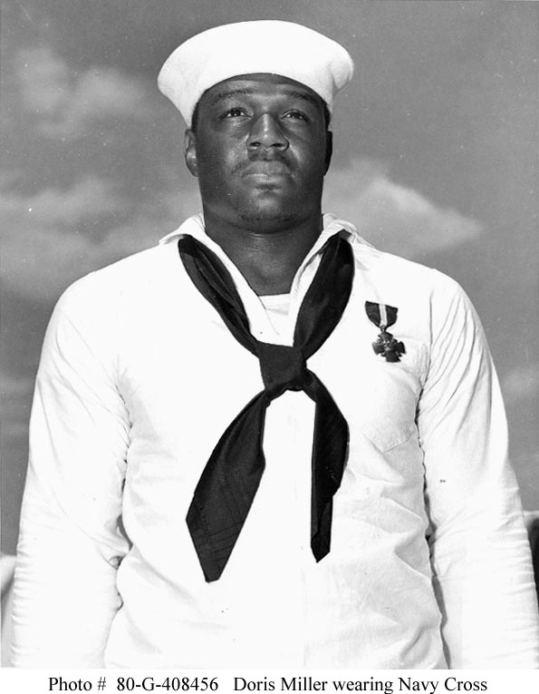 Doris Miller, Mess Attendant Second Class, USN (1919-1943) Just after being presented with the Navy Cross by Admiral Chester W. Nimitz, on board USS Enterprise (CV-6) at Pearl Harbor, 27 May 1942. The medal was awarded for heroism on board USS West Virginia (BB-48) during the Pearl Harbor Attack, 7 December 1941. (Navy)