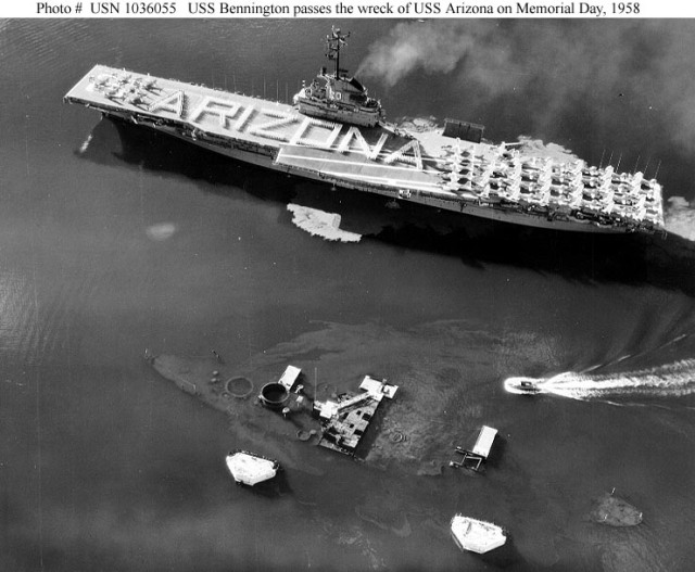 USS Bennington (CVA-20) Passes the wreck of USS Arizona (BB-39) in Pearl Harbor, Hawaii, on Memorial Day, 31 May 1958. Bennington's crew is in formation on the flight deck, spelling out a tribute to the Arizona's crewmen who were lost in the 7 December 1941 Japanese attack on Pearl Harbor. Note the outline of Arizona's hull and the flow of oil from her fuel tanks. (Navy)